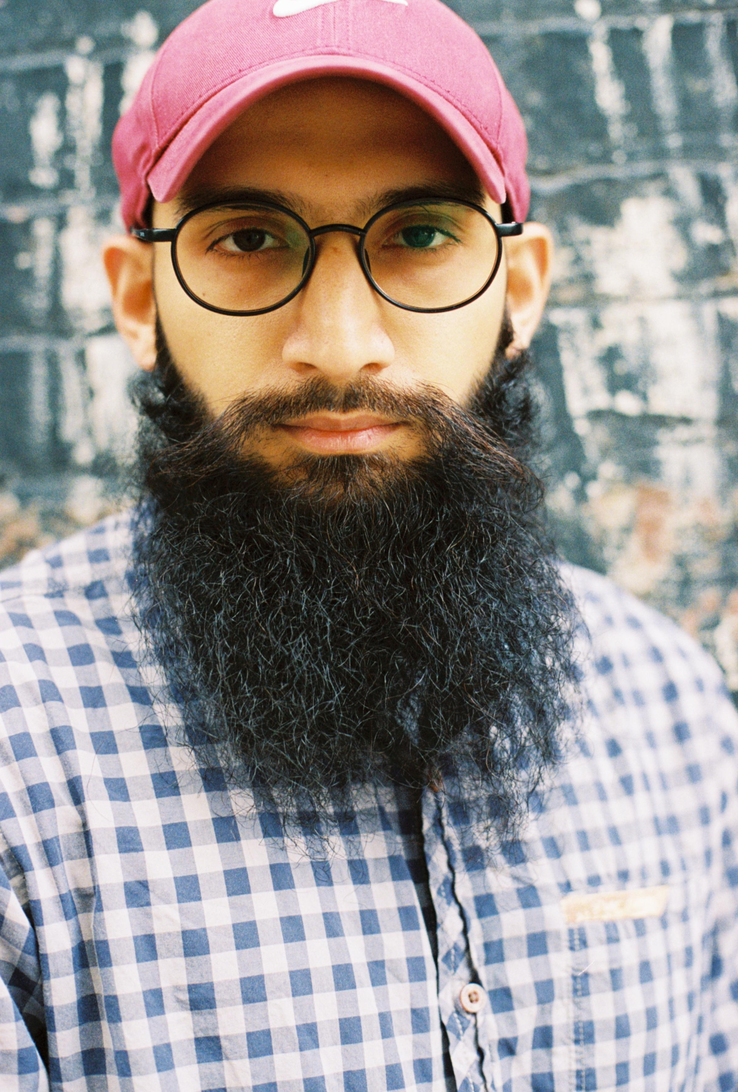 MD in his usual appearance. Beard. Headwear. Specs. Long sleeves.