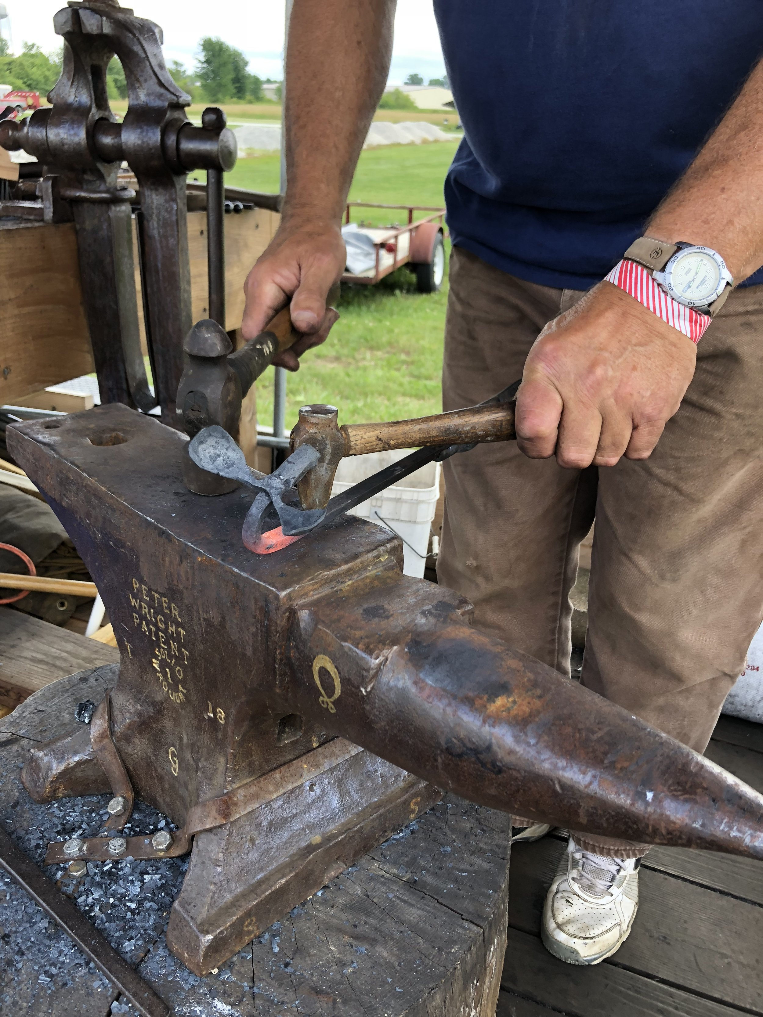 After bending the neck over the horn of the anvil, begin to swage the nail holes with a modified ball peen hammer.