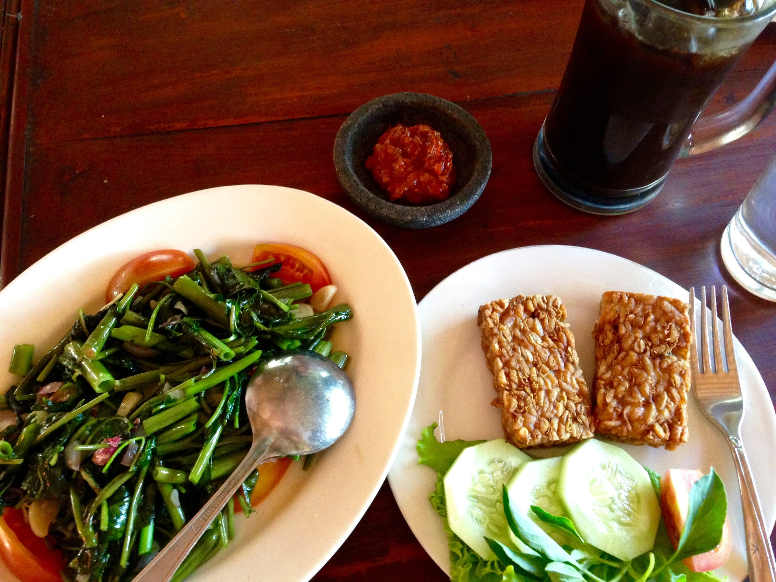 Garlicky water spinach with fried tempeh for lunch, one of my favourite meals of the trip.