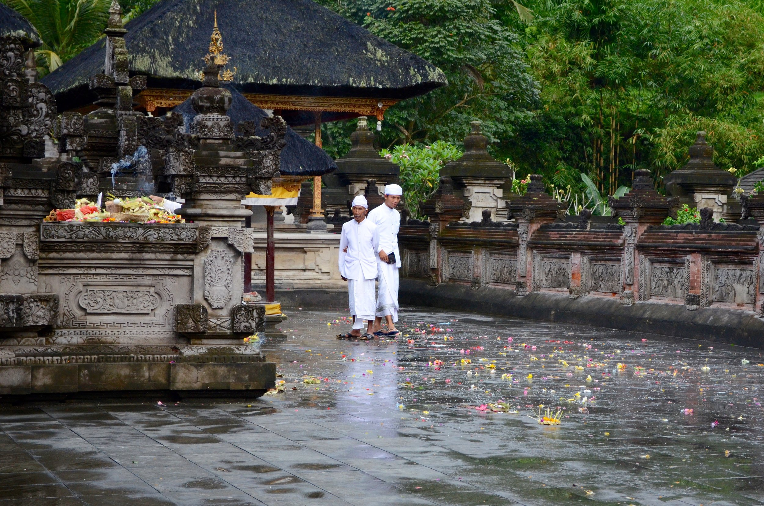 Priests among the colourful offerings after a ceremony at Tirta Empul, a water temple near Ubud, Bali.