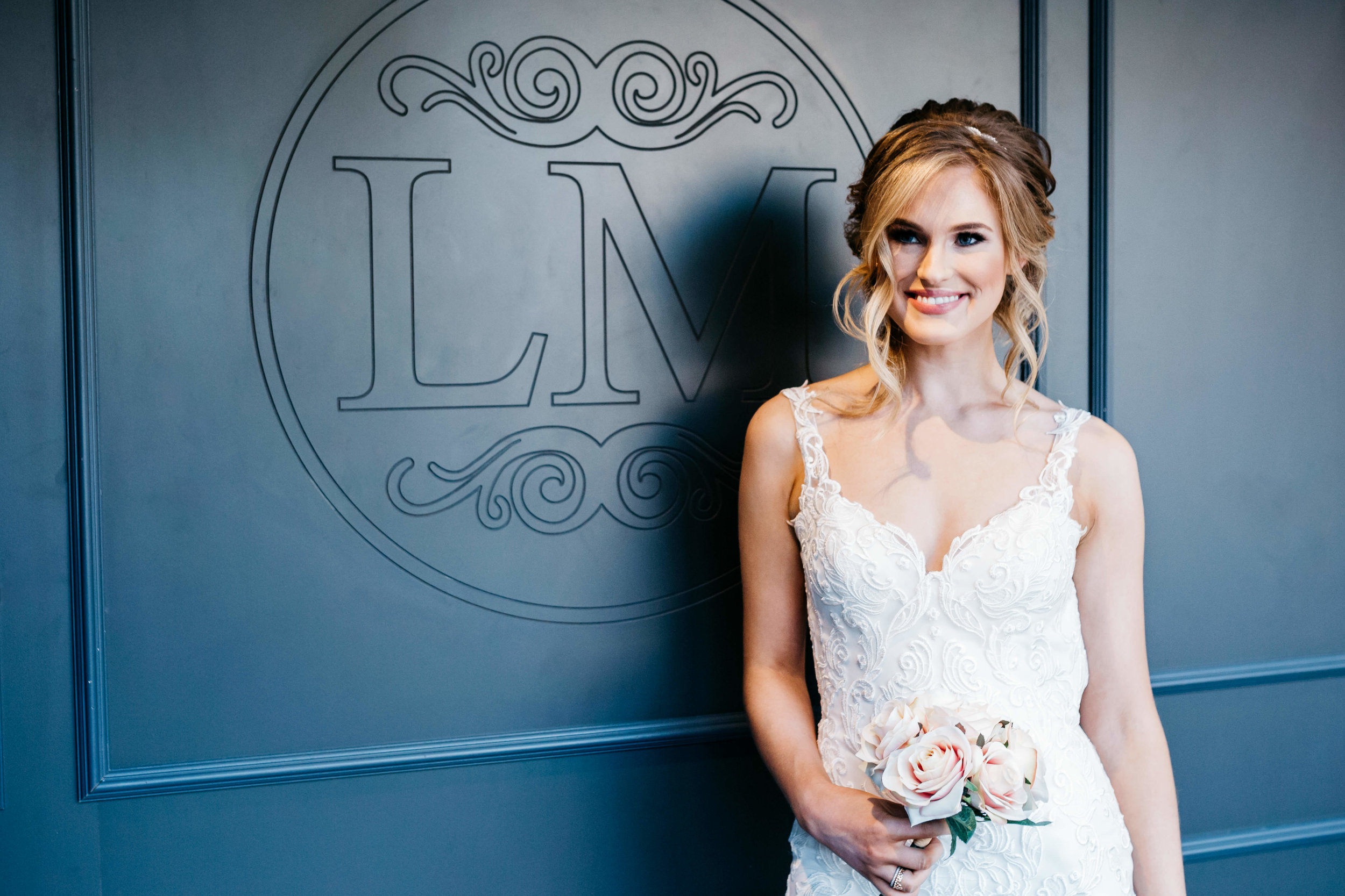smiling bride hair and make up session at la mode.jpg