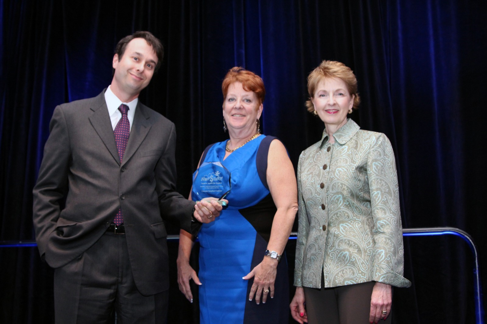 The Colorado Jump$tart Coalition accepts the 2013 State Coalition of the Year Award. Those pictured above include (from left to right): Jason Alderman, Visa Inc; Colorado Jump$tart Coalition Executive Director, C.J. Juleff; and Mary Medley, President & CEO, Colorado Society of CPAs and chairman of the Colorado Coalition board of directors.