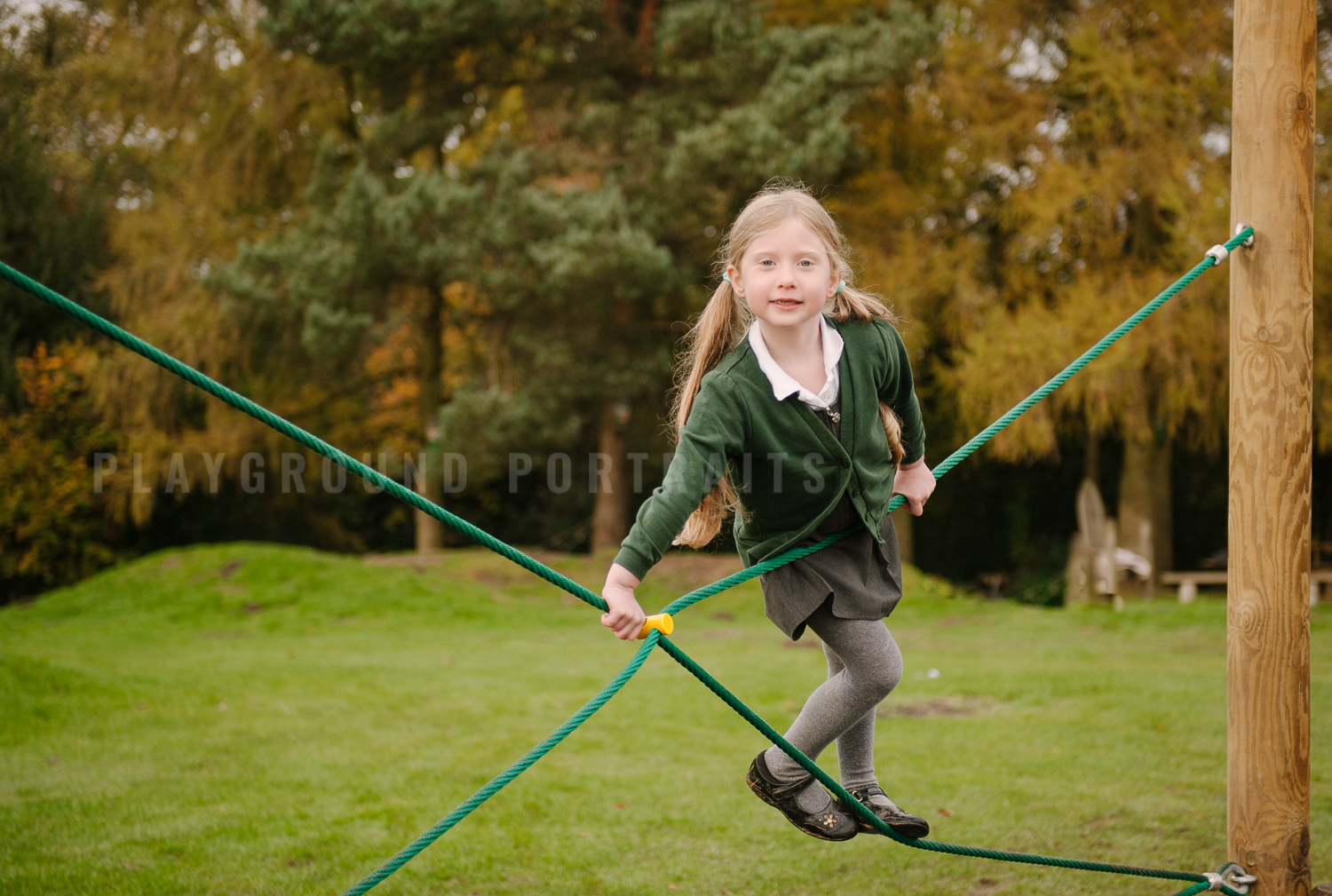 child playing on climbing frame photography