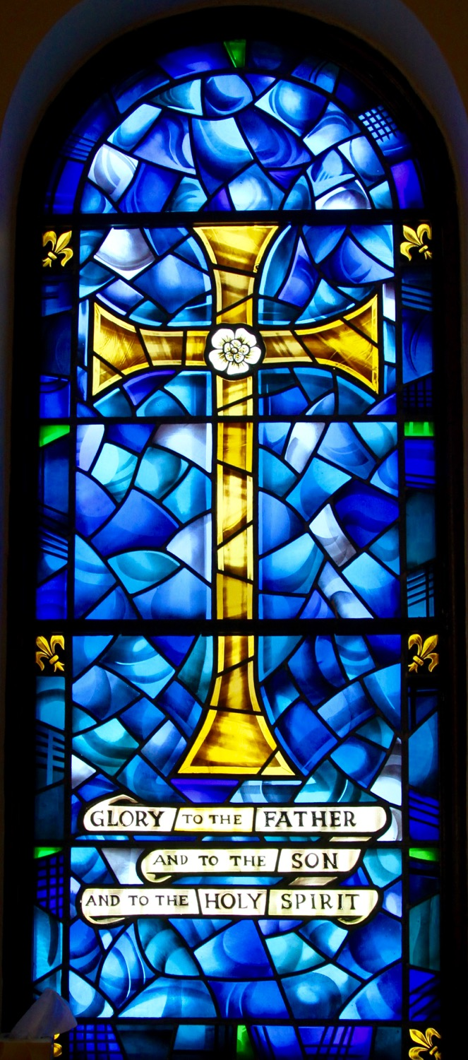 the church is graced with beautiful stained glass windows set into rounded niches along the east and west walls of the sanctuary and behind the altar.  Click here  to see them all.