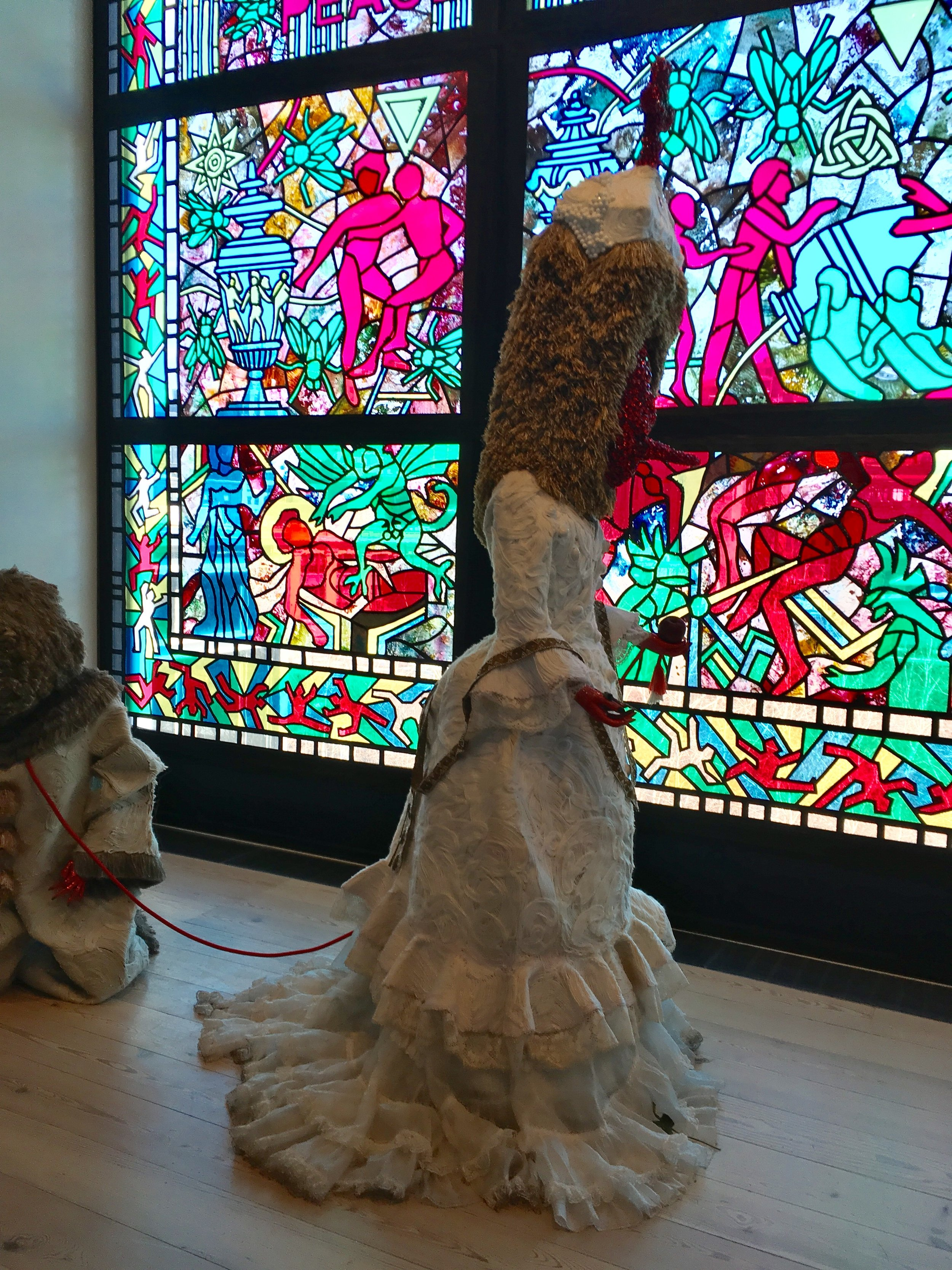 The figures are made out of beads and other fabric embellishments. This piece was called, 'Somos Monstros'. His work explores life-and-death through religion, fashion, nature. His dedication to craftsmanship is obvious.