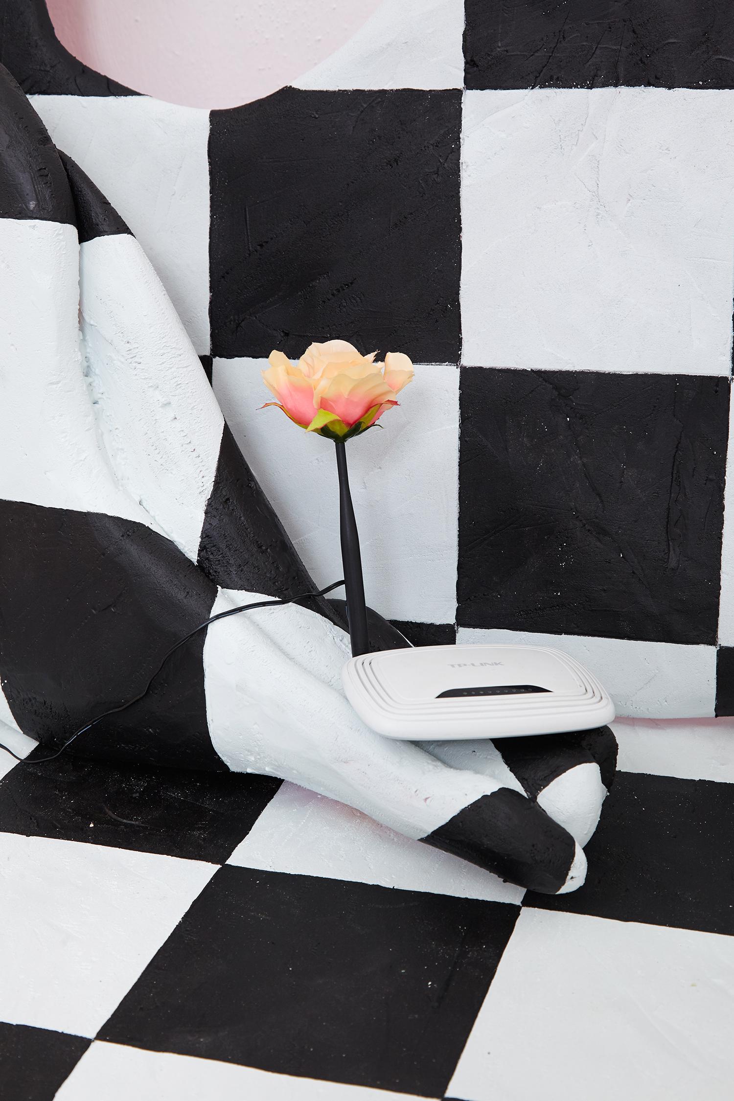It Wasn't Us Who Told Lizi to Lie Down on the Cold Kitchen Floor, 2016, styrofoam, acrylic paint, router, artifical flower, Macbook box, thread. | Photo: Krisztián Zana.