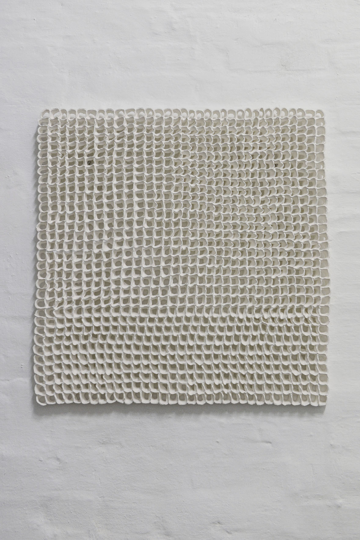 "Stine Jespersen ""Clay Knit"" (Earthenware Mat white, 65x65x2 cm). Photo: Valérie Collart."