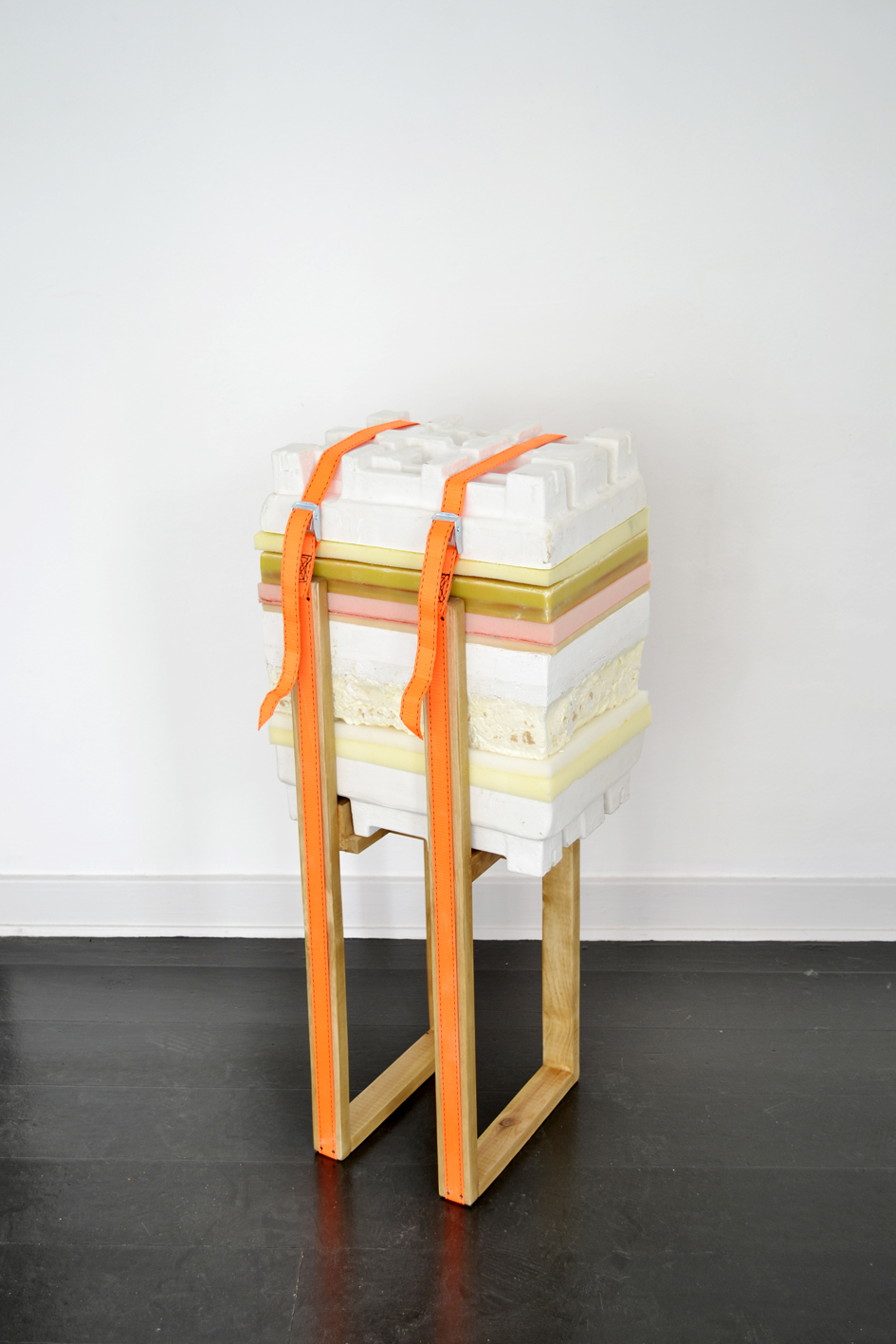 "Anne Bak ""How To Handle Accumulation #1,� 2019 (wax, foam, PU-foam, plaster, straps and wood, 89 x 37 x 27 cm)."