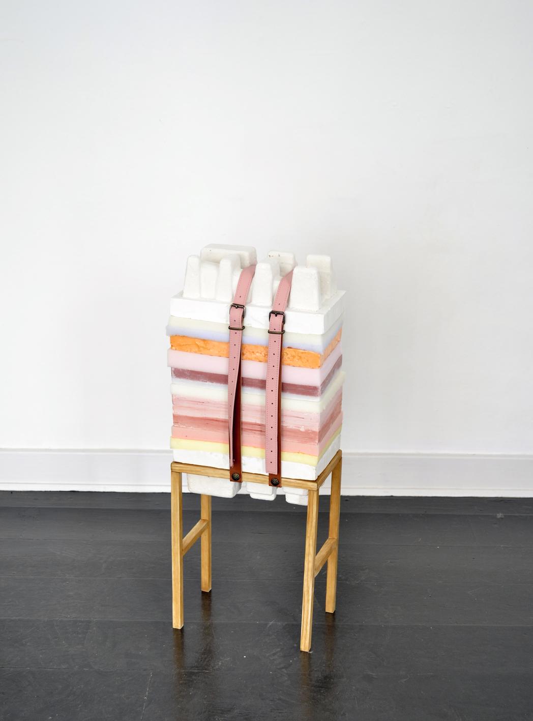 "Anne Bak ""How To Handle Accumulation #2,� 2019 (wax, foam, clay, styrofoam, latex, leather straps and wood, 67 x 25 x 15 cm)."