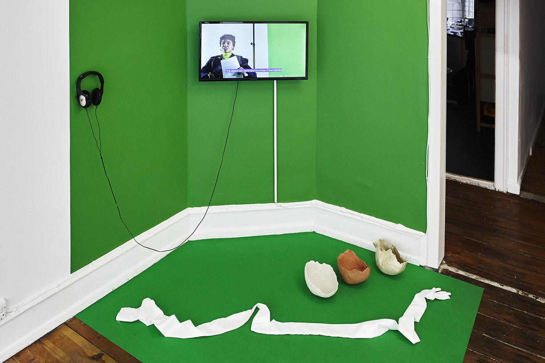 Rosa-Johan Uddoh, The Serve: Set (Installation with glove, ceramics & green screen).  Photo: SixtyEight Art Institute, 2019.