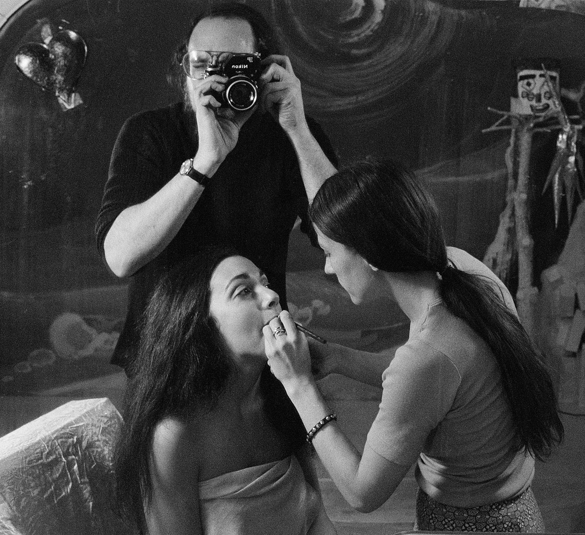 Photographer  Peter Angelo Simon  observing a model's makeup for a photoshoot in the Chelsea