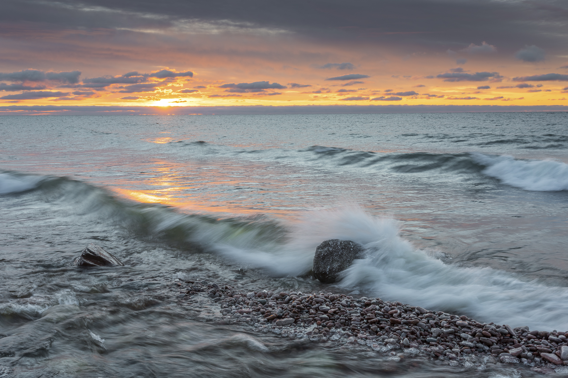 Lake Superior sunrise: mouth of Kadunce River, MN.