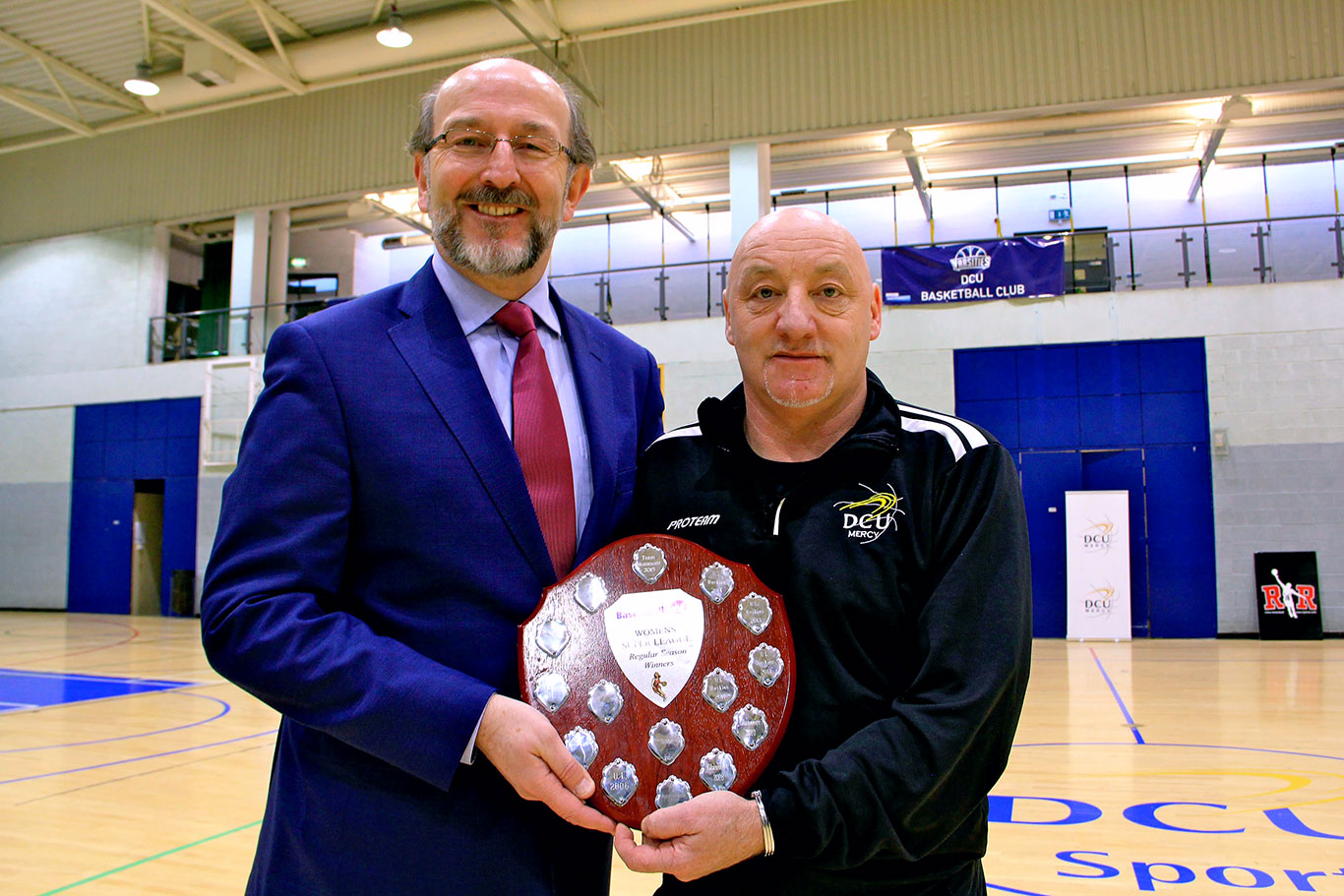Mark Ingle Head Coach of DCU Mercy Superleague Team with Brian McCraith President of DCU with the Basketball Ireland Regular Season winners trophy 2016