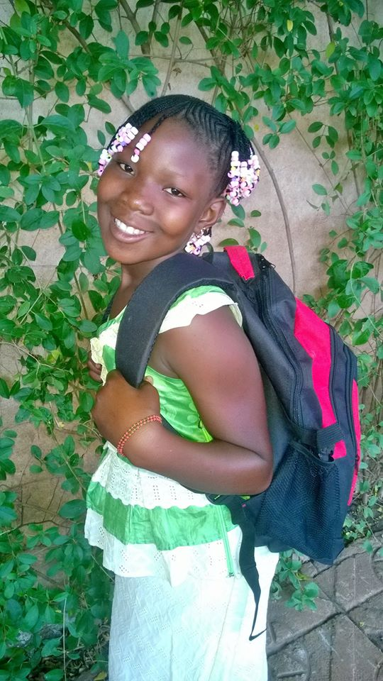 A young girl in Kolimba, where our new Nieta Kalanso Middle School welcomed students back to school this week.