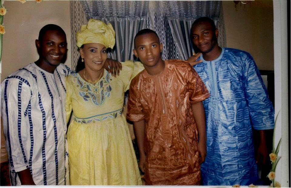 Salifou's proud mother with her three sons. Something that is the same in Mali and the US: parents are proud when their children excel in school!