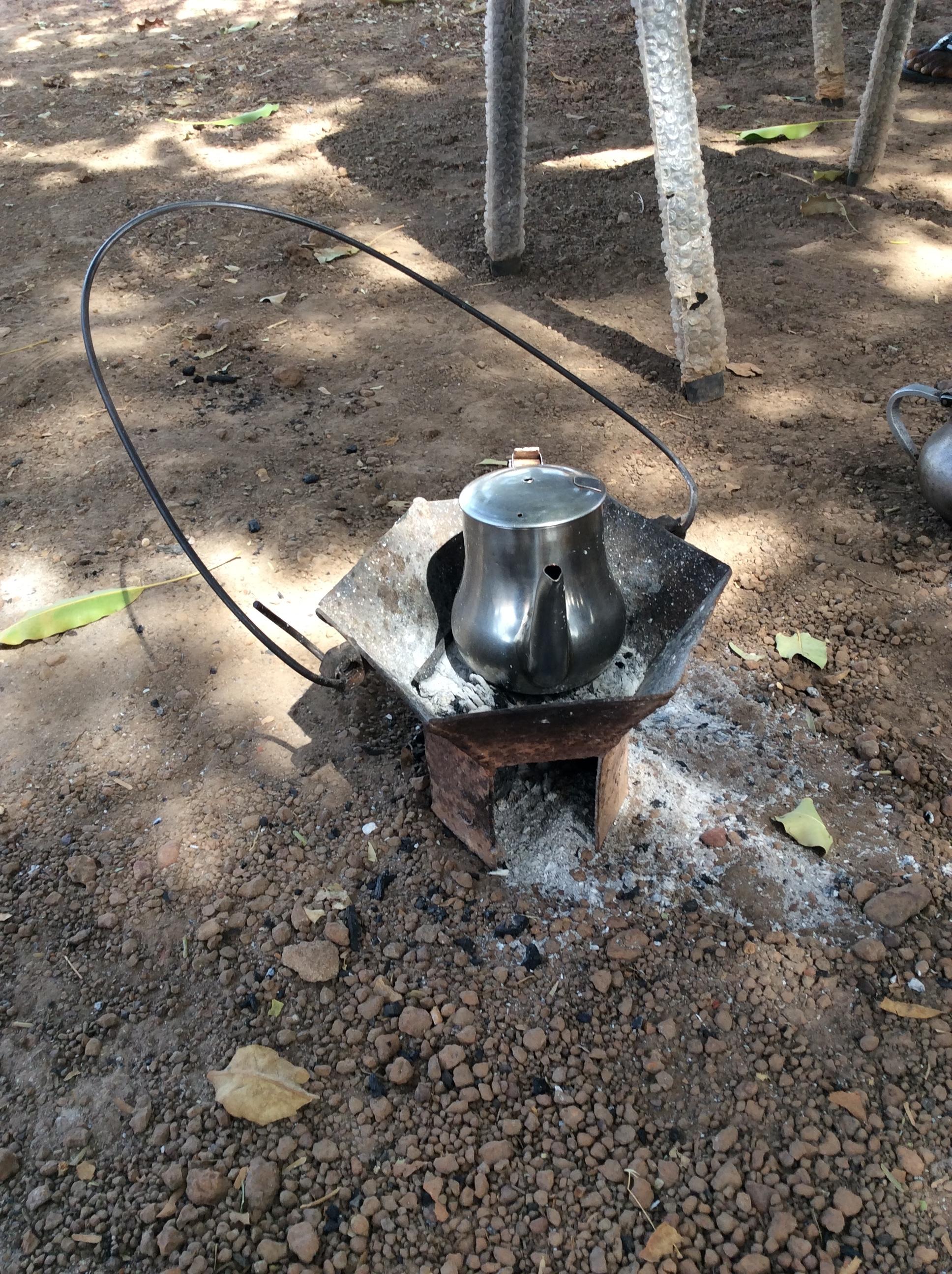 Teachers making tea in the school yard while on a break.