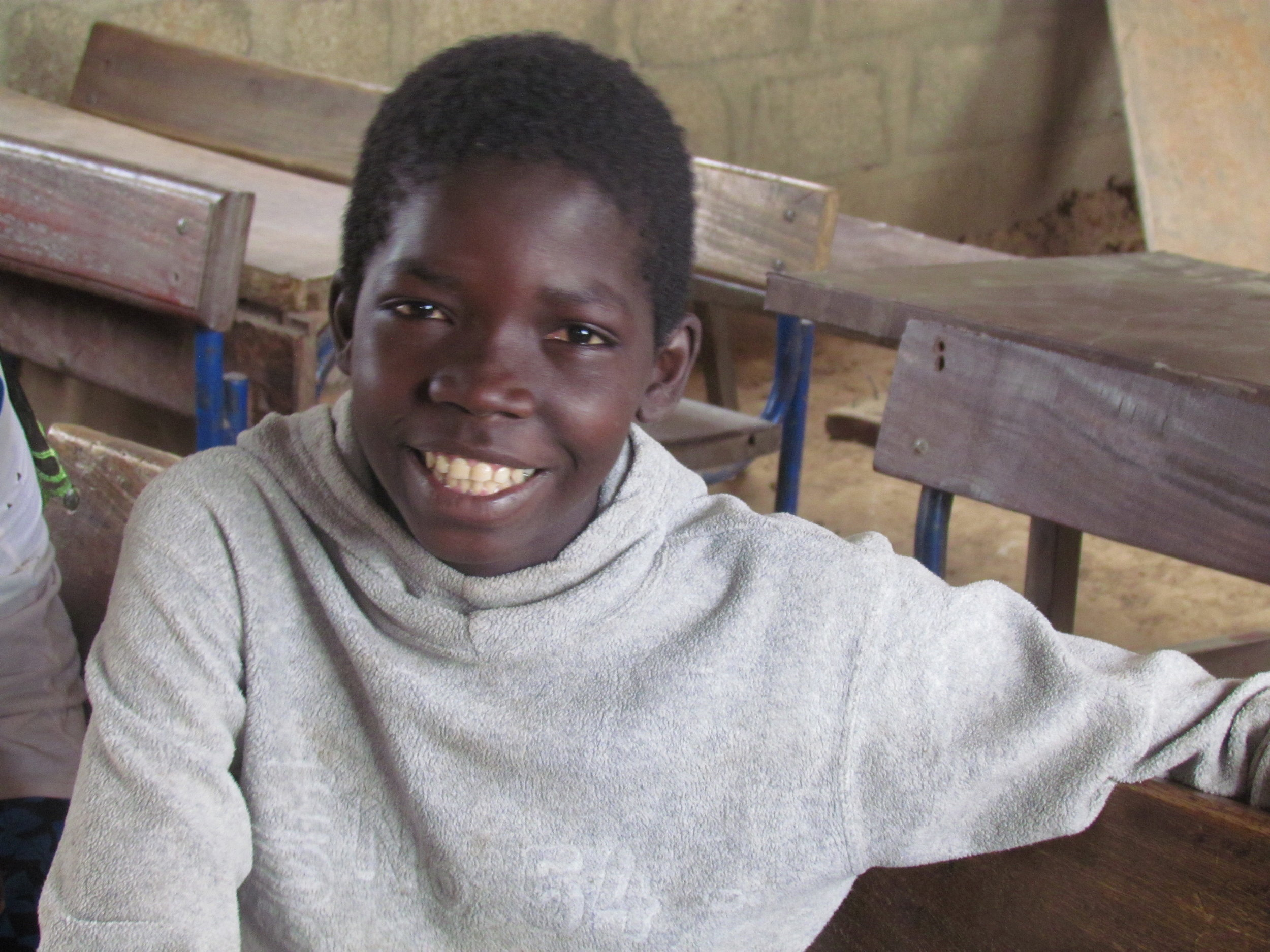This is Lassine of Sebela, Mali. Although he is proud of being 4th in his class, he promises us he will be #1 by the time we visit again.