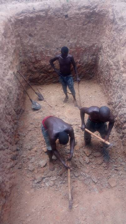 Digging latrines by hand is real work. REAL work.