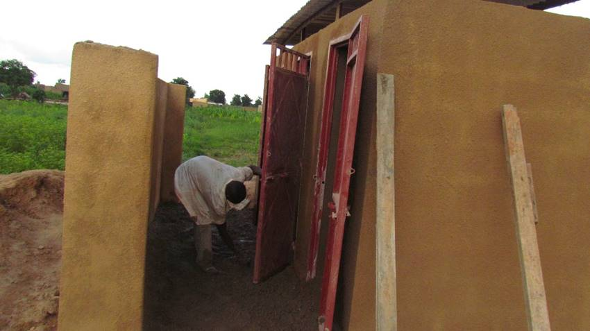 Putting the finishing touches on one of two banks of latrines.