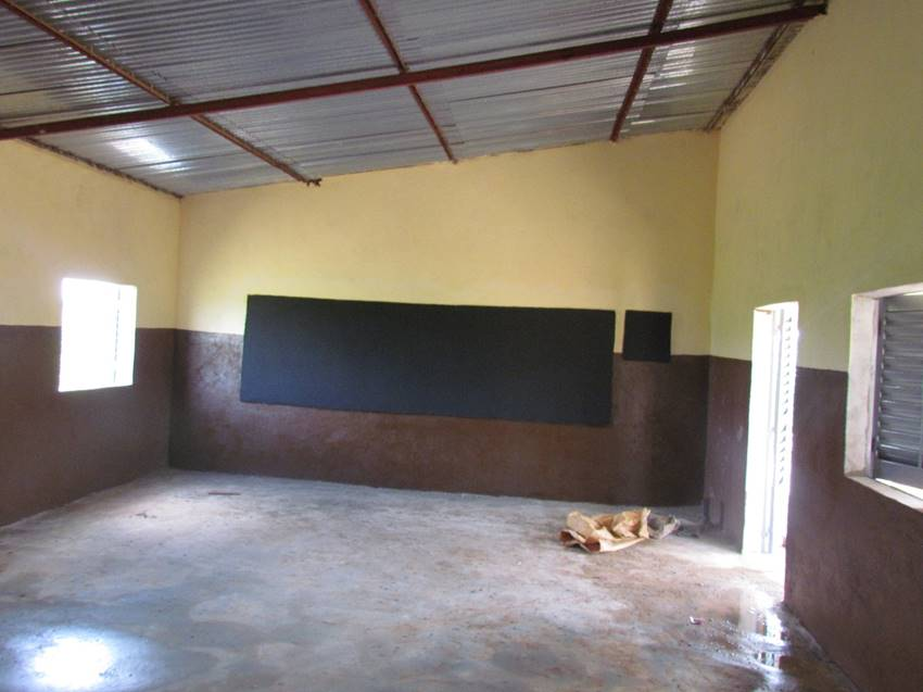 A peek inside a finished classroom. Note the built-in chalkboards -- a large one for lessons and a small one for posting the daily attendance. The classrooms are designed to use natural light and encourage air flow...a relief in Mali's hot climate.