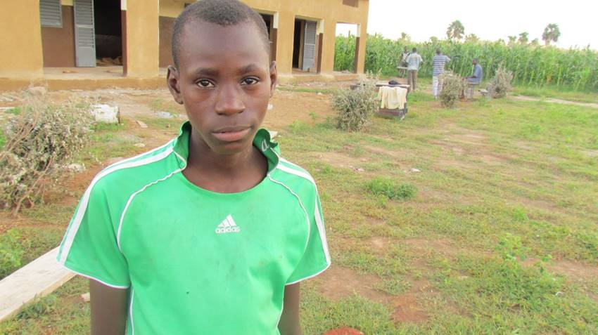This young man stopped by the site to thank us for bringing a school to his village. He recently graduated the 9th grade, but had to walk several miles to school each day because Sebela had no middle school.