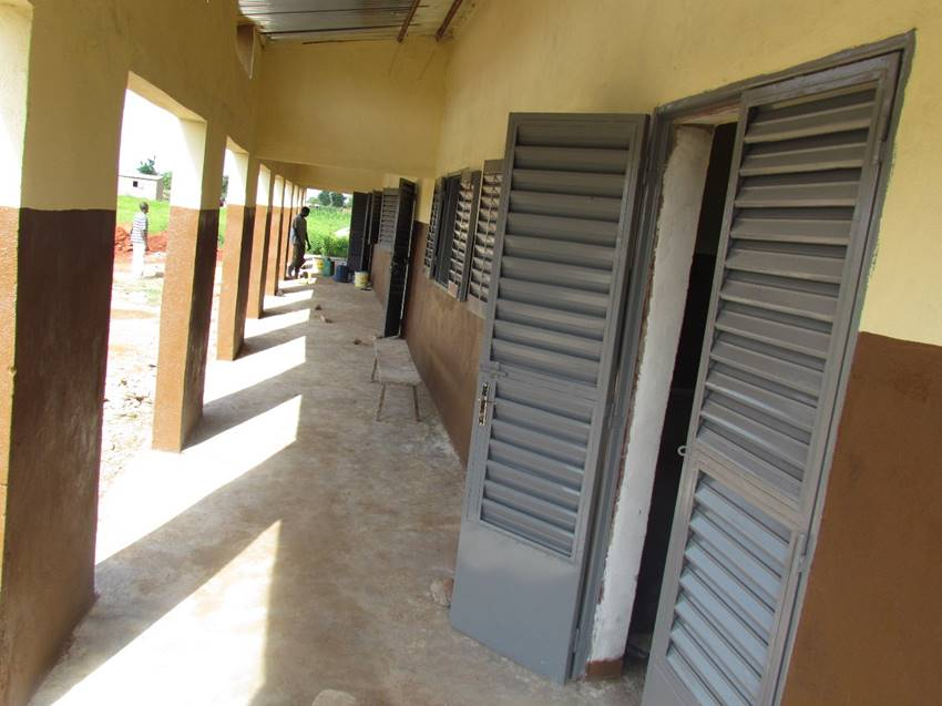 A view down the shady veranda connecting the three classrooms. Doors and windows are made of metal slated panels to encourage airflow.
