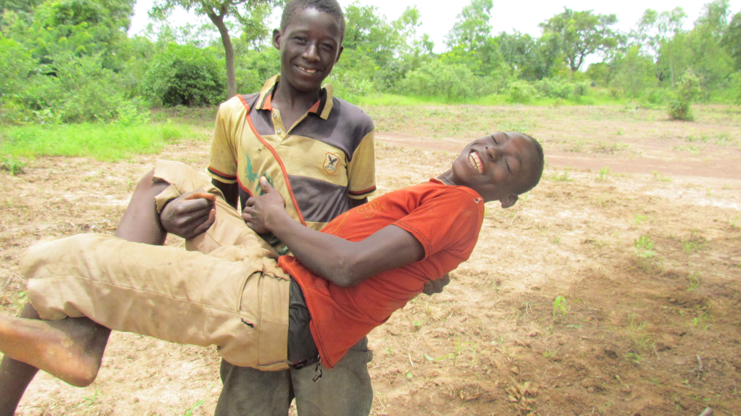 Life isn't all serious even for kids in Mali...horseplay is an international language.