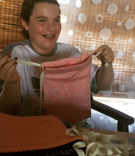Skyler shows of a kit bag -- the simplest piece to sew in the kits.