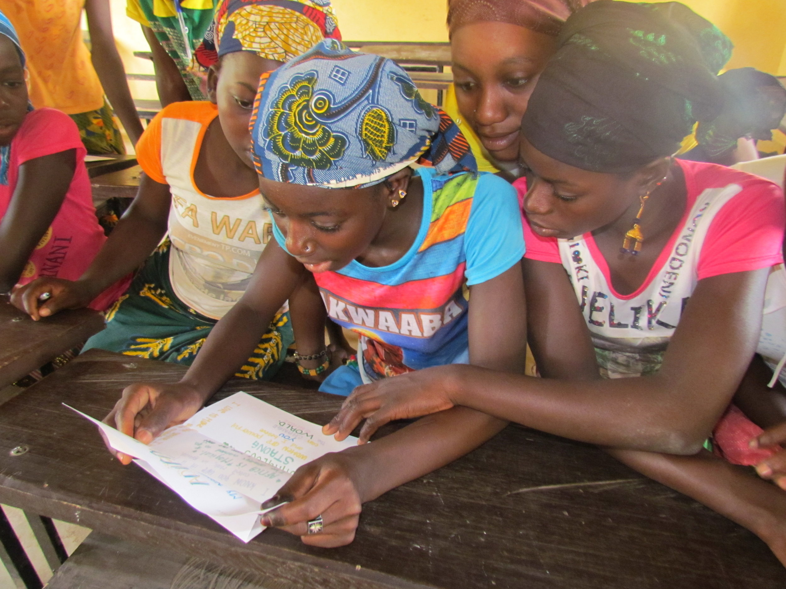 Girls Project participants in Kolimba share the excitement of reading letters of encouragement from U.S. Girl Scouts.