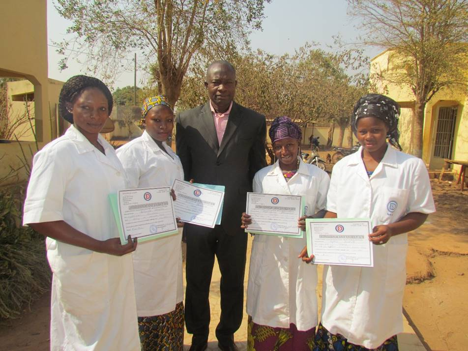 Our Field Director, Alou, celebrates with our graduates.
