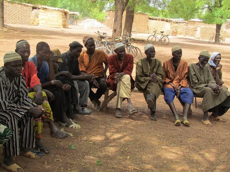 Village elders looking on.