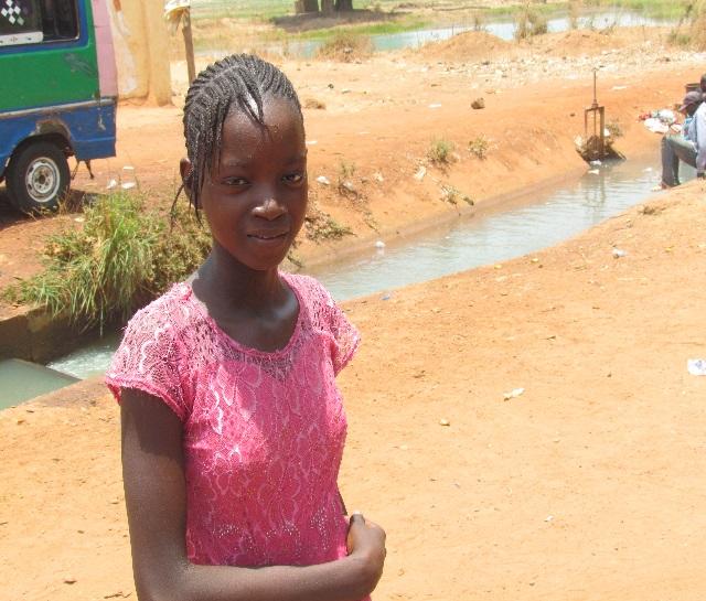 Fatoumata's friend Oumou half way to school.