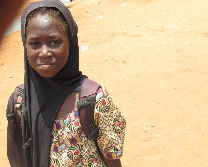 Seventh grader Djeneba on the road.