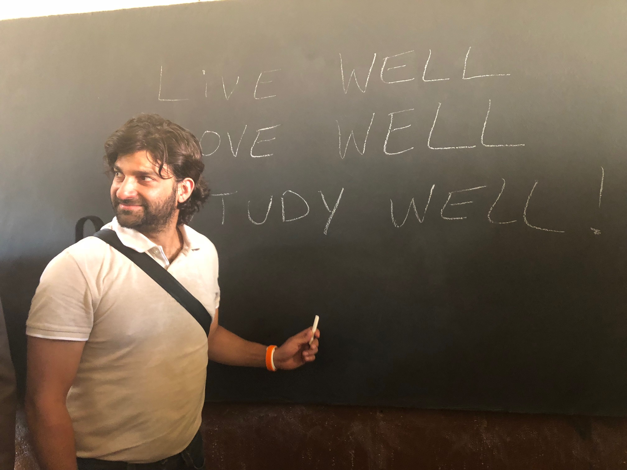 Ilias breaks in the new chalkboard in the 9th grade classroom.