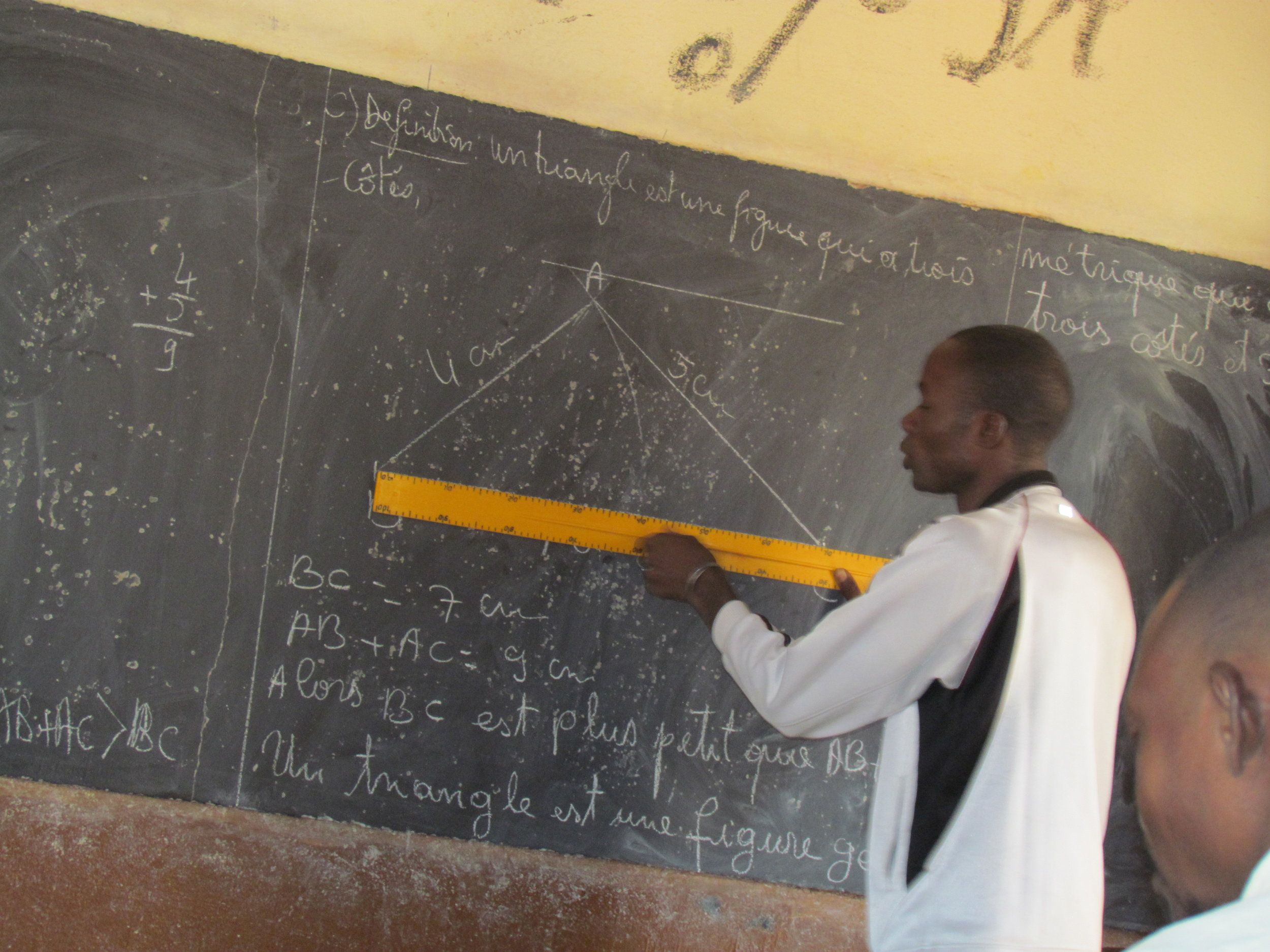 Sequessona math teacher teacher giving a geometry lesson during the teacher peer meeting.
