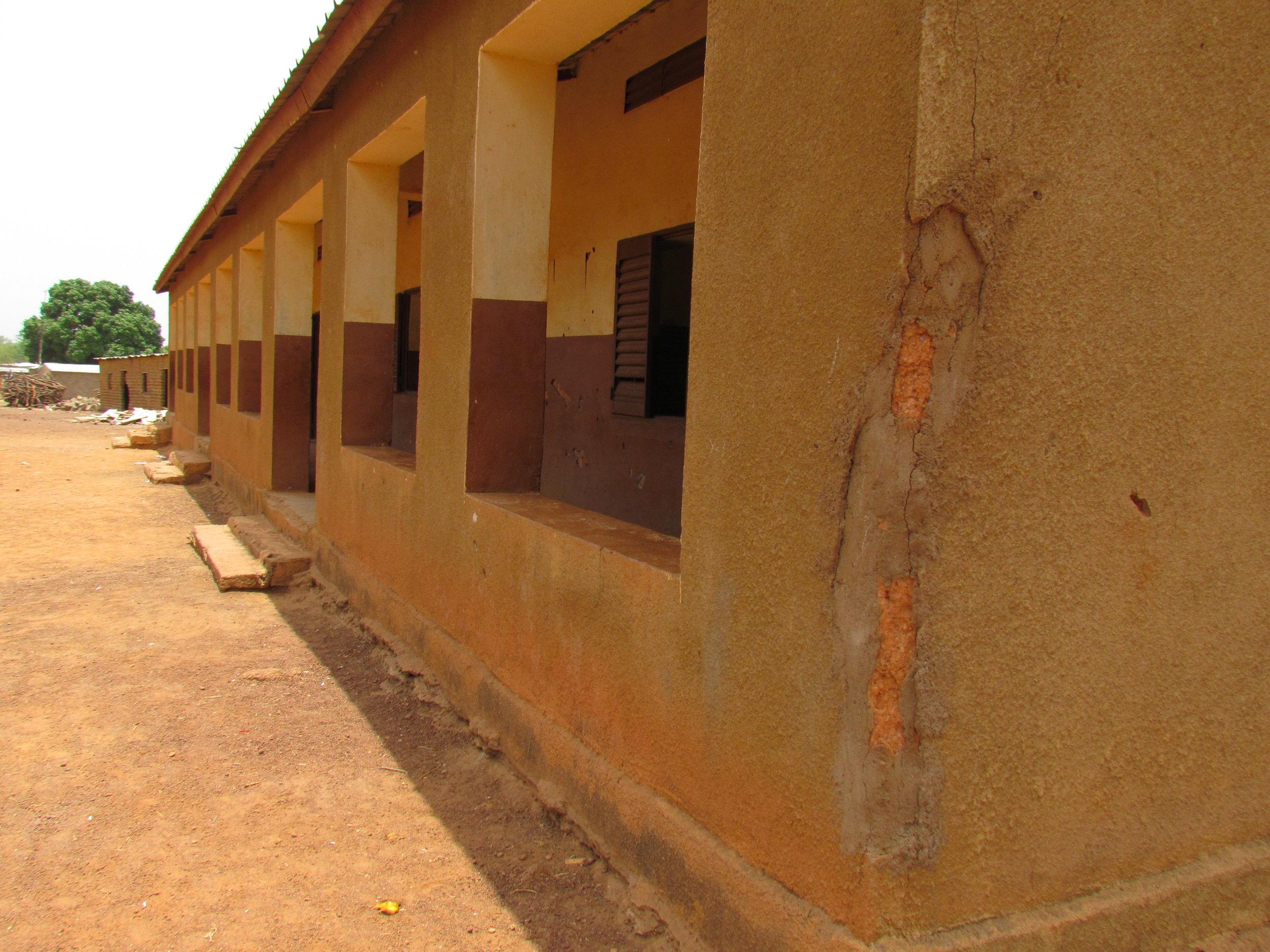 Corner cracking seen on some older, mud schools before repair.