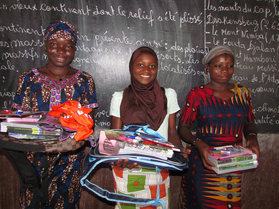 Siraba with school supplies she won for being top girl last year.