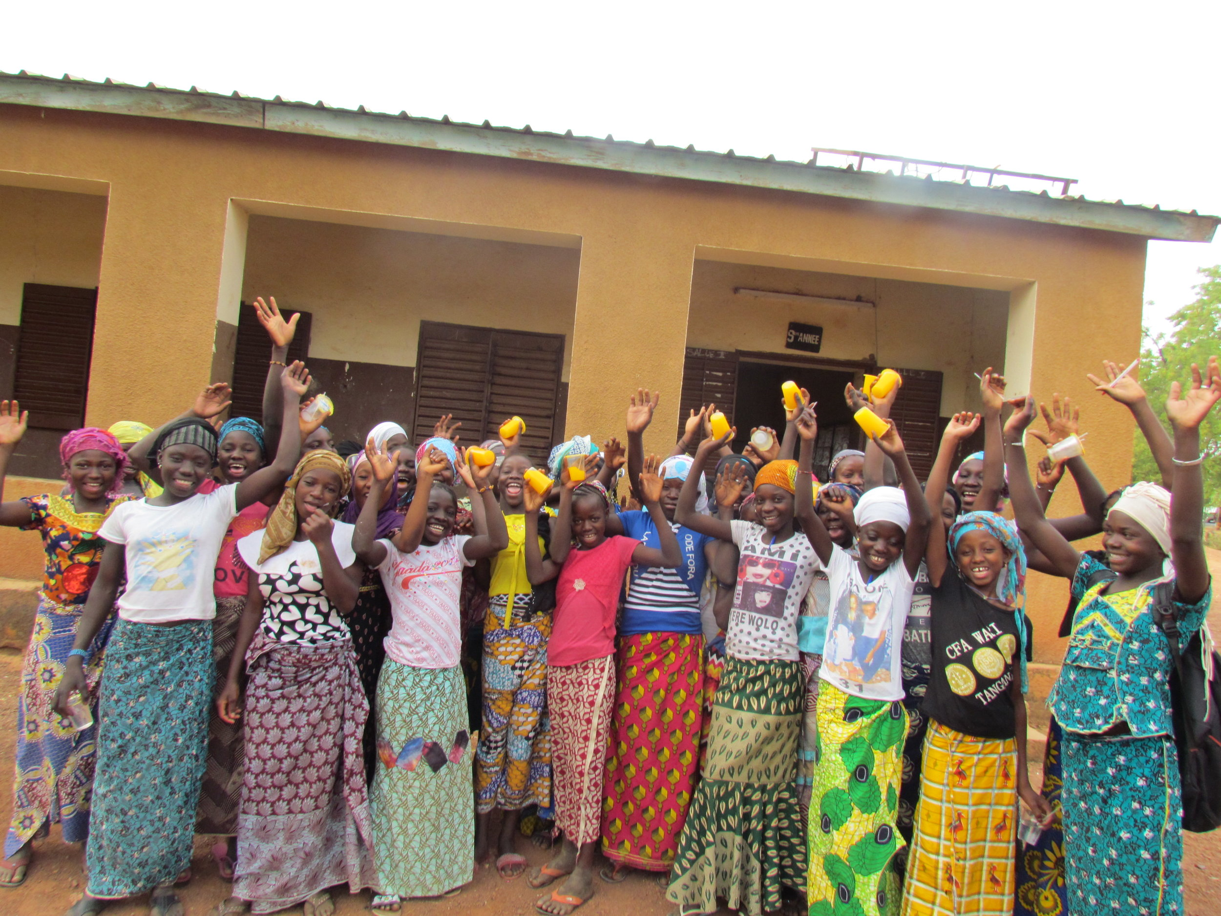 Some of our Girls Project participants in Simidji celebrate after a leadership training where they developed their skills and formed support groups to help each other stay in school.