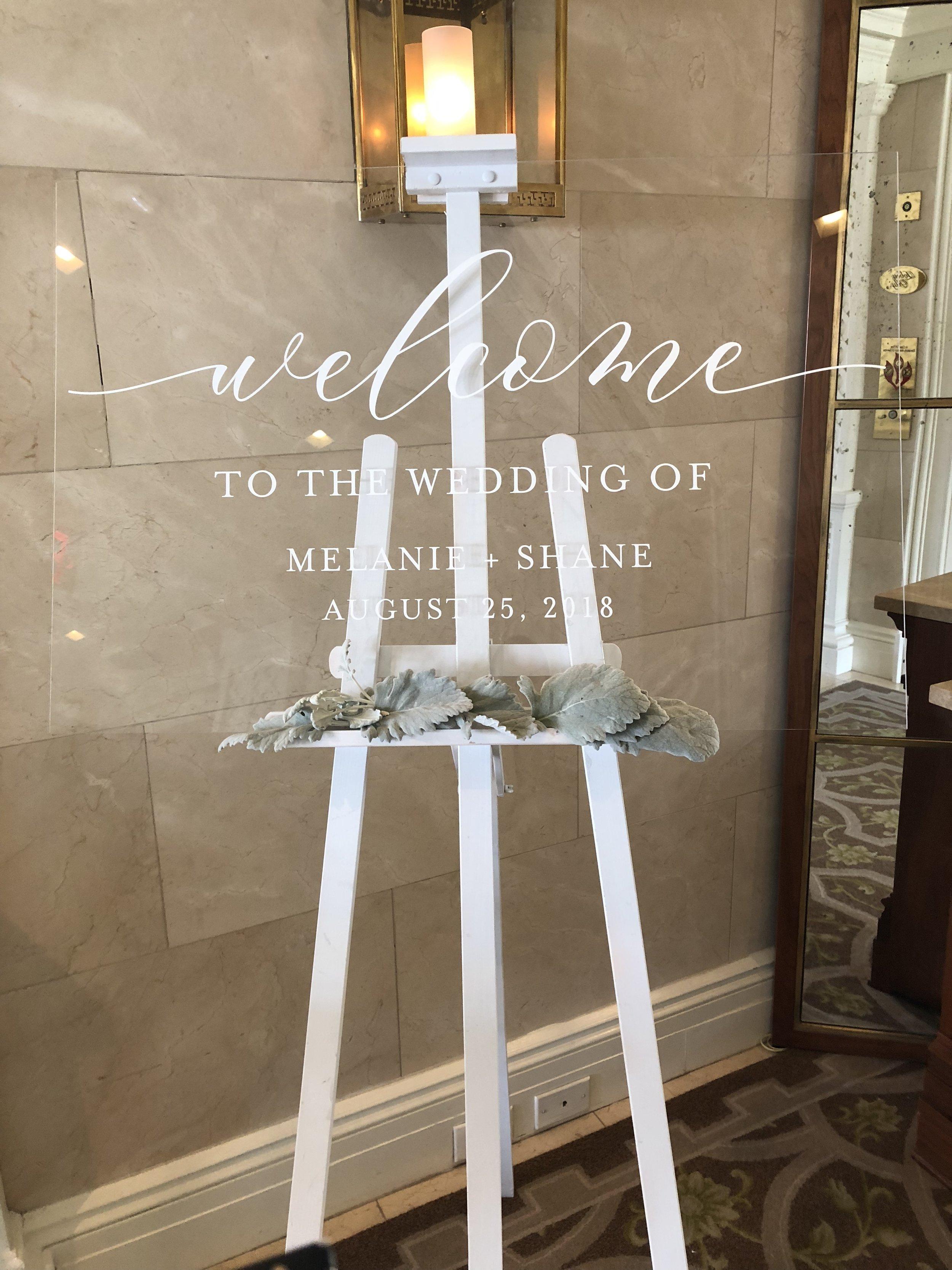 mel+shane acrylic welcome sign.jpeg