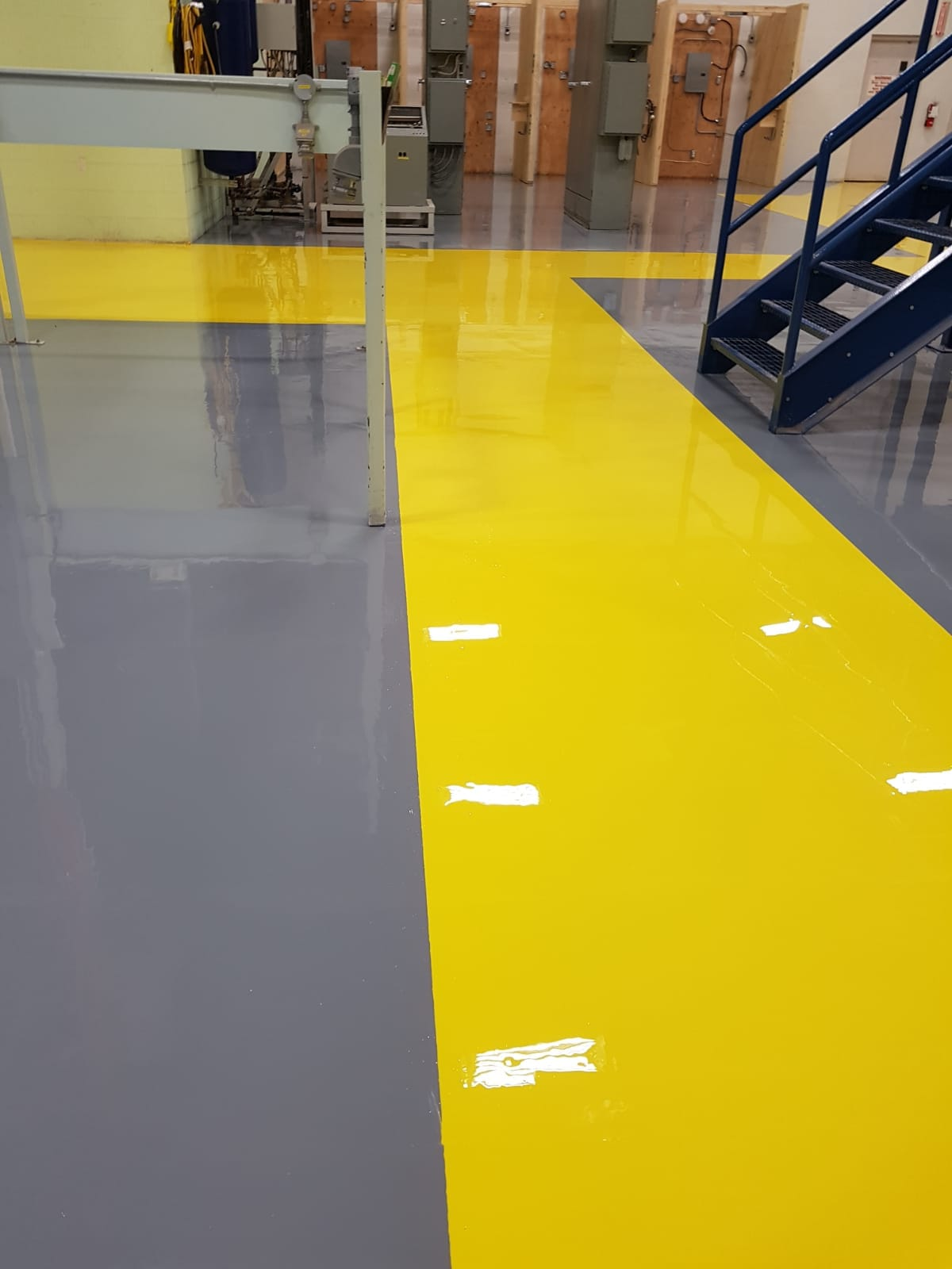 Epoxy Coating with Safety Yellow walkway to keep pedestrians at a safe distance from machinery.