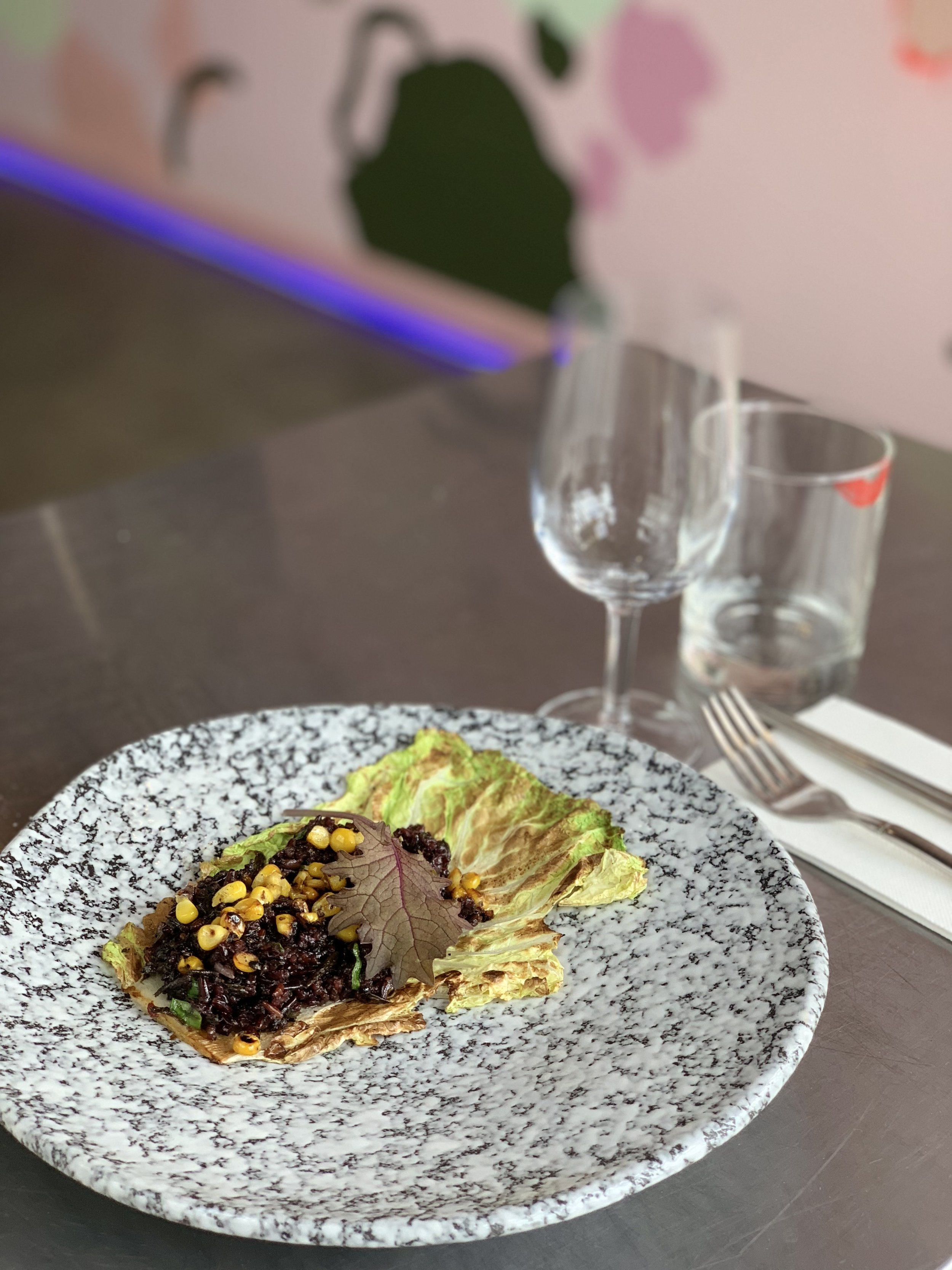 Grilled Chinese cabbage, black sticky rice with corn and preserved olive leaves