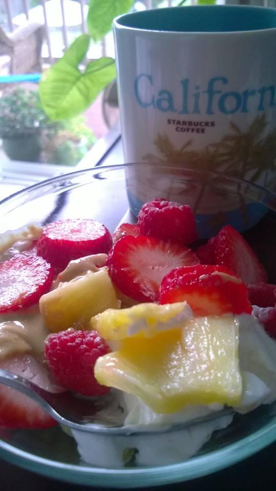 Plain yogurt, fruit and coffee.