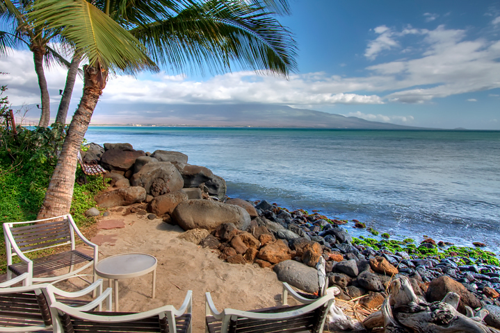 View humpback whales in Maalaea Bay from a waterfront condo at Maalaea Banyans.