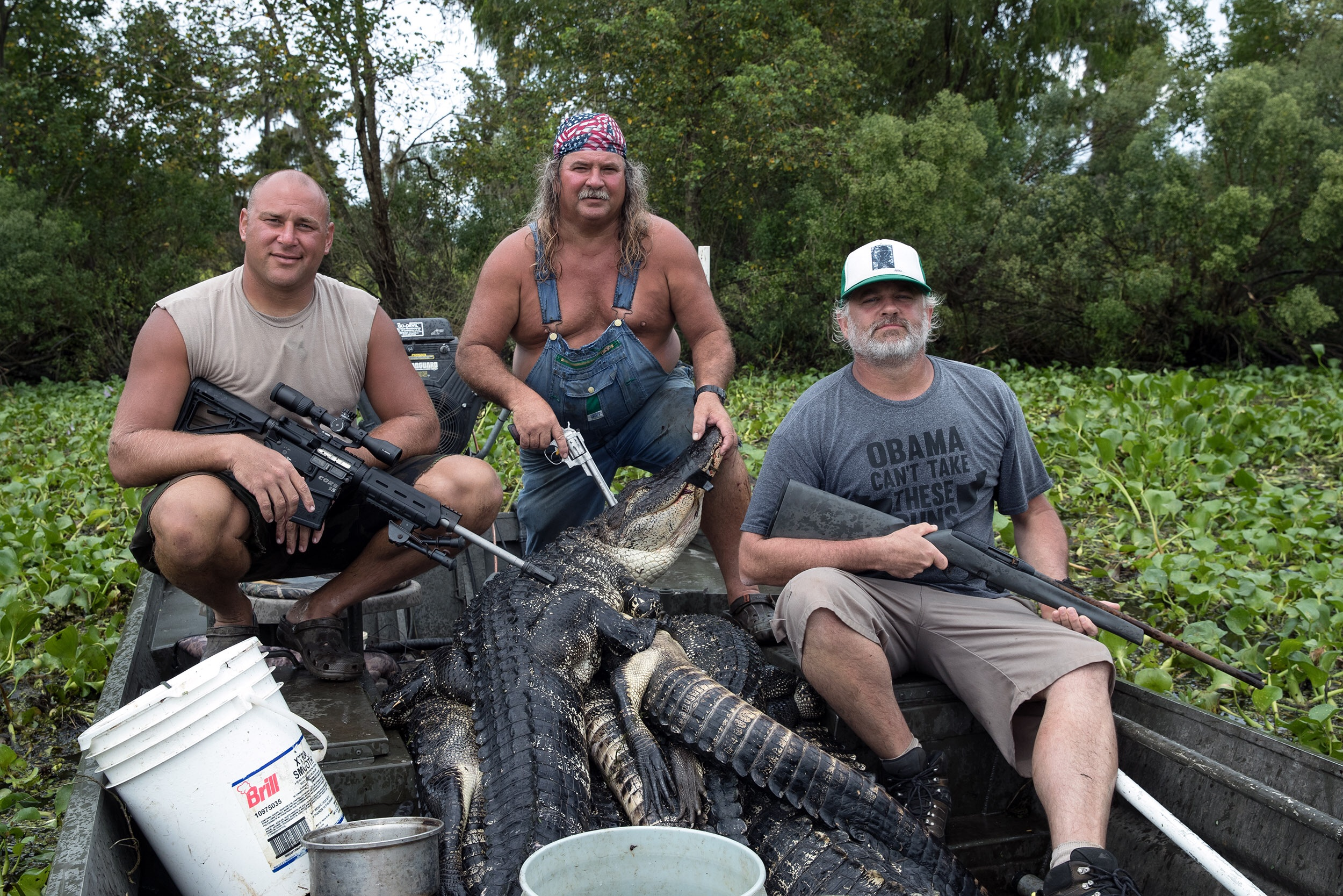 """Ron, Bruce, Matt, and a bunch of gators who had a bad day. FYI: the shirt says """"Obama can't take these guns"""" with arrows pointing to my arms. #swamppeople #historychannel #dbrproductions www.dbrpro.com  📷: """"Pompo"""" Alfonso Bresciani"""