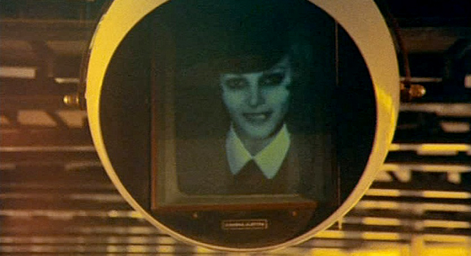Toby Dammit  The modernist video globe - in the form of an eye - contains what looks like an old black and white photograph in a conventional frame with a caption we can't read. Orwell's television that looks back at you comes from the past with an apparently friendly face - modern technocracy at its most insidious.