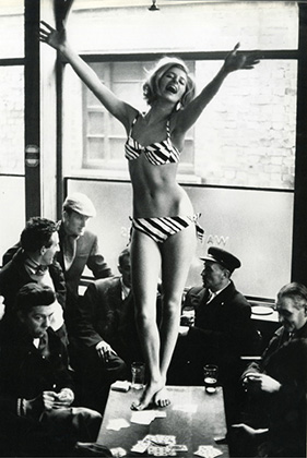 John Cowan, World's End Pub KIng's Road, Chelsea April 3, 1963  The photographer contrasts different ages and classes to incredible effect. Note that the men are all caught up in their own actions or lost in thought giving greater weight to the model's exuberant sense of play and beautiful contraposto pose - the one note that acknowledges the classical style.