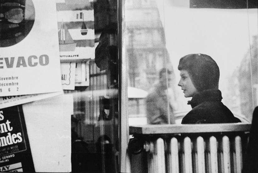 Ronald Traeger,  Paris 1962  for Elle magazine (unpublished) The model looks at someone blocked to us by random layering of adverts and text reminiscent of a cubist paper collage, while in the background a random male passerby looks on resigned, hands in pockets - the poetics of urban space was never expressed more beautifully.