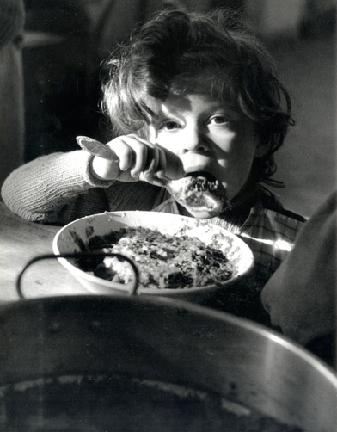 Italian Child in a Refugee Camp, Ticino, Italy, 1945  Werner Bischof