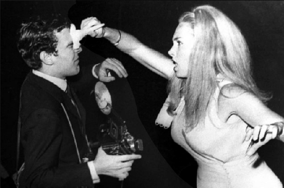 Unknown photographer,  Paparazzo Rino Barillari is attacked (with an ice cream cone) by actress Sonia Romanoff,  1966