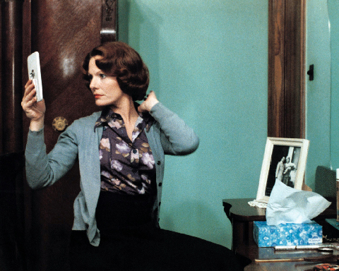 Chantal Akerman, (film still)  Jeanne Dielman, 23 Commerce Quay, 1080 Brussels , 1975 The main character is beautifully framed between frames - the mirror that she looks at on the left and the black and white portrait on the right.